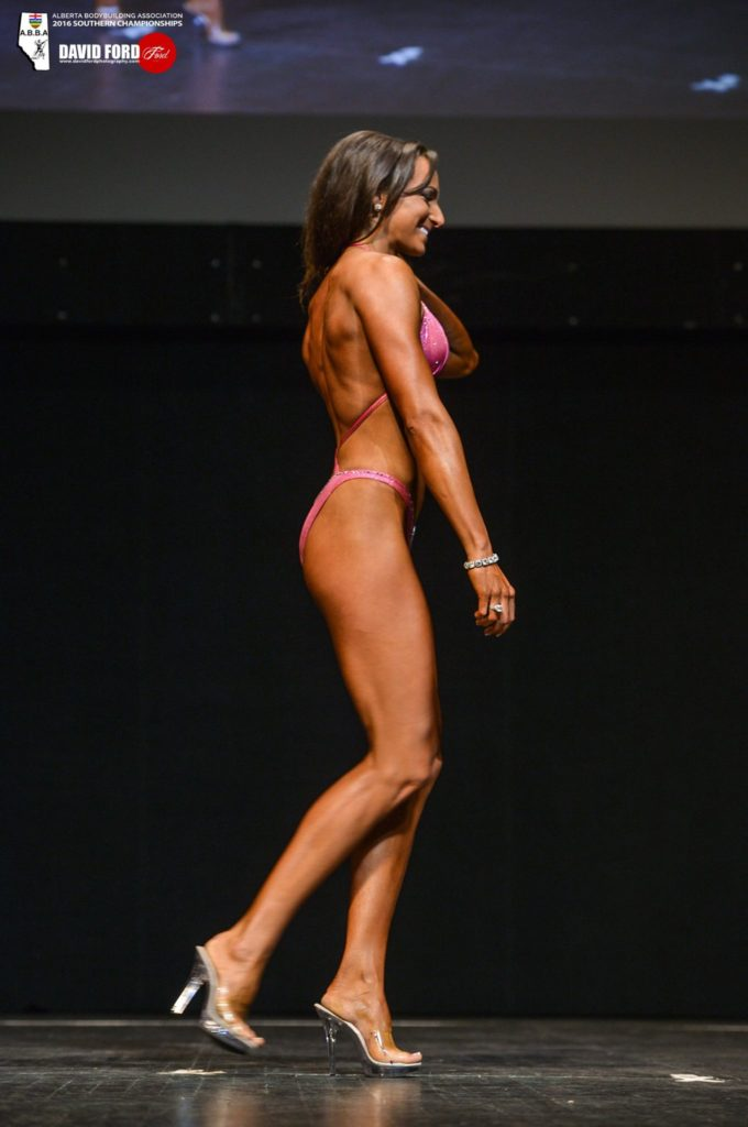 Dr. Mandy in a bodybuilding competition walking