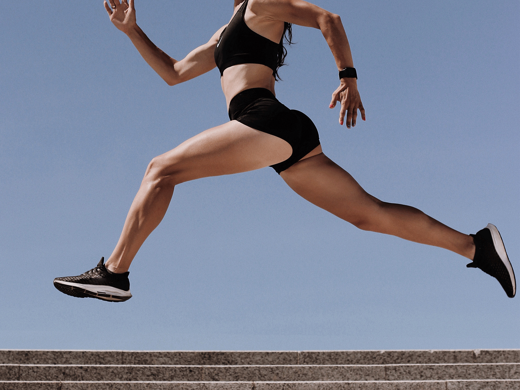 Athletic fit woman sprinting