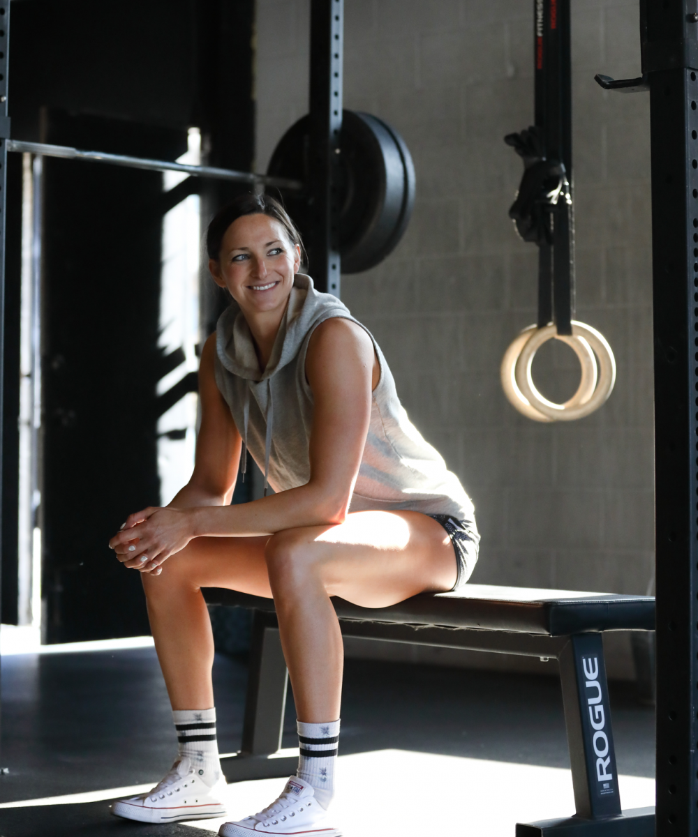 Naturopathic doctor posing at the gym on a bench